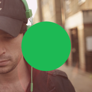 a Spotify green circle overlayed onto an image